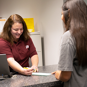 Student being assisted at the Financial Aid Office